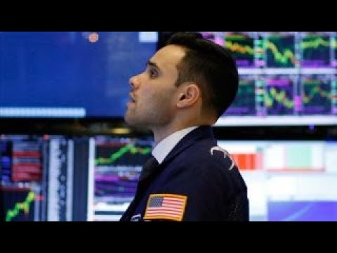 Dow closes at record after Fed raises rates