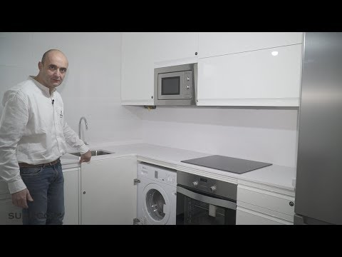 Cocina pequeña moderna blanca !! ZONA DE BARRA!! sin tiradores silestone blanco zeus