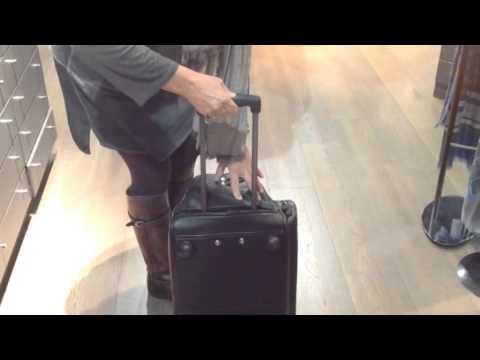 Bolsa trolley de viaje en piel con bolsillo exterior delantero y ruedas - Solohombre