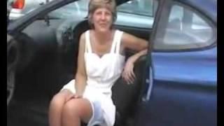Mature upskirt in a car.
