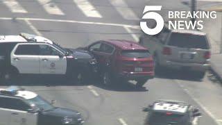 LAPD Cruiser Rams Stolen Vehicle in South L.A. Pursuit