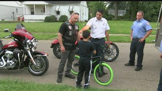 Youngstown firefighters, police and EMTs surprise hit-and-run victim with new bike