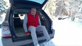Range Rover Sport L322 driven in a snowy Switzerland