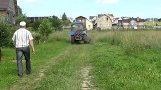 Окос травы трактором