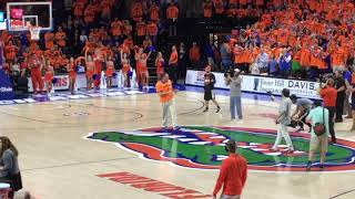 Florida football coach Dan Mullen addresses fans at halftime of basketball game