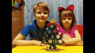 Nikita and Milana dress up a beautiful Christmas tree