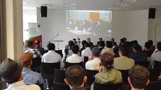 Shunichi Fujiki speaking at BNM Berlin Conference