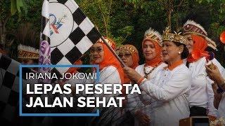 Pegang Bendera Start, Iriana Jokowi Lepas Peserta Jalan Sehat Keluarga di Plaza Timur Senayan