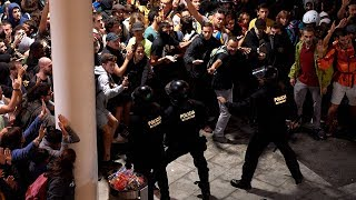 video: Chaos at Barcelona airport as protesters clash with police after independence leaders jailed