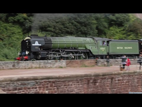 LNER 60163 'Tornado' passes along Teignmouth sea wall with '…