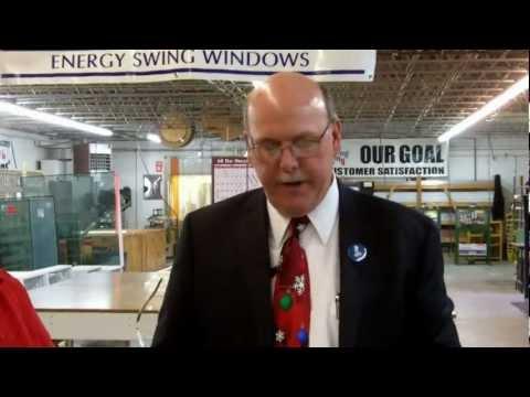 Warren King, President of The Western PA Better Business Bureau, presents Energy Swing Windows with the 2012 Better Business Bureau Torch Award for Marketplace Ethics.