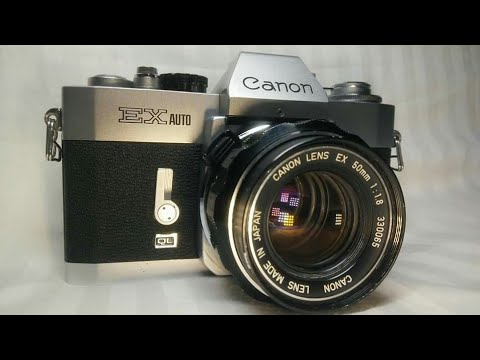 VINTAGE 35mm Canon EX Auto film camera  with Canon 50mm f:1.8 fixed lens.