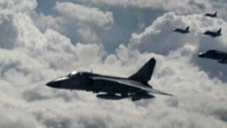 Tensions rise after China flies warplanes over disputed islands