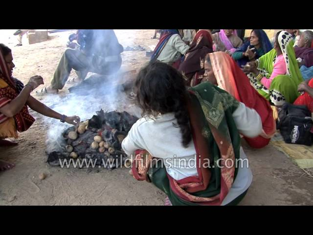 Indian-women-cook-potatoes-by