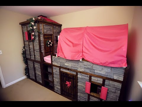 An IKEA children's bed converted into a castle with tower and secret passage.