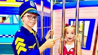 Max becomes a policeman in the game center and play with Katy