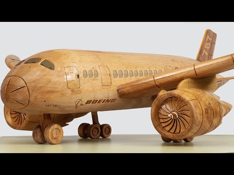 wood carving sculpture boeing 787 plane by wood world
