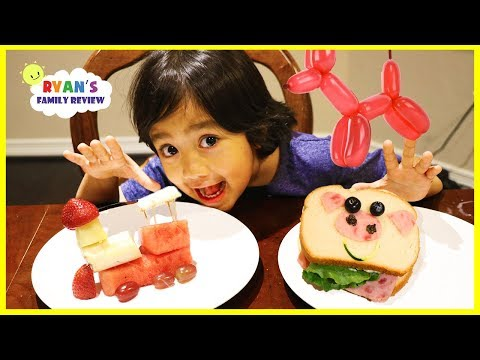 Ryan makes fun food for kids with animal shaped sandwich and fruit train!
