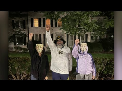Former Michigan running back Jon Vaughn staging protest outside University of Michigan president
