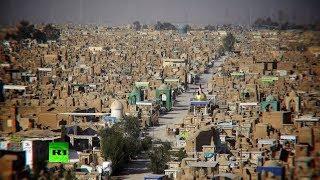 Коллекция оружия ИГ и крупнейшее кладбище шиитов: RT побывал у иракских ополченцев