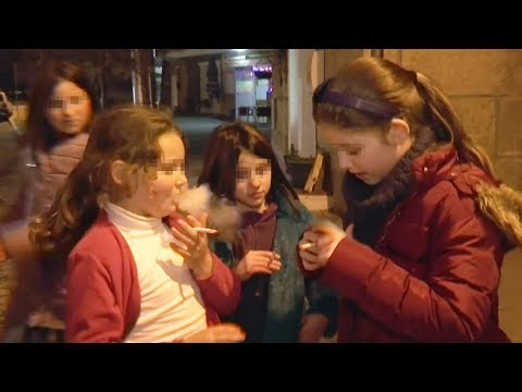 Parents encourage their children to smoke cigarettes in a Portuguese village