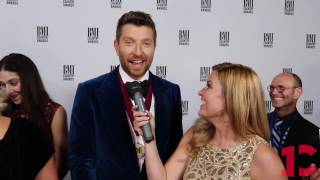 Brett Eldredge Finds Out The Cubs Score On The BMI Red Carpet