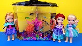 FISH TANK ! Elsa and Anna toddlers visit Ariel
