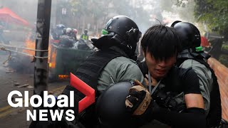 Hong Kong police arrest protesters attempting to leave besieged university campus