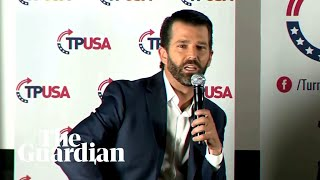 Donald Trump Jr heckled and booed off stage at his book launch