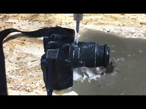 Watch A Canon SLR Get Cut Perfectly In Half With High-Pressure Water