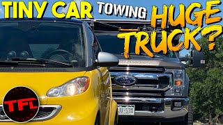 Can I Tow A GIANT Truck With A TINY Car?   Ford F-250 Vs Electric Smart Car!