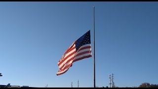 American flags fly at half-staff