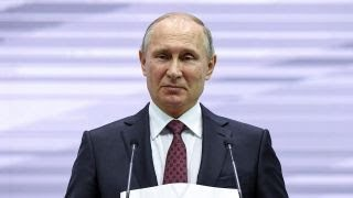 Putin pulls troops out of Syria