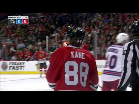 Gotta See It: Kane gets crushed against the boards then goes high on Miller