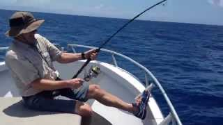POPPER FISHING FOR GIANT TREVALLY ON THE REEF FROM CAIRNS FAR NORTH QUEENSLAND AUSTRALIA