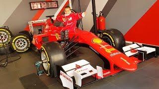 Funny Baby in Ferrari Land for Kids Ride on POWER WHEEL Car Family Fun Playtime