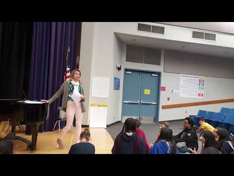 Watch Ms. Erin leading a theatre class at Challenger Middle School.