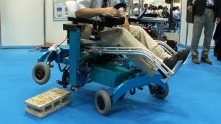 Robotic wheelchair from Chiba Tech turns wheels into legs and climbs over steps #DigInfo