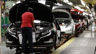 GM shares jump after company announces plan to cut jobs, close plants