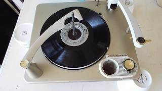 RCA 4 speed, automatic record changer playing a 16 RPM record.