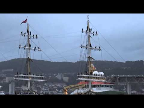 "Sailors singing ""Good Old Norway"" from every mast as their ship enters harbor after a four month voyage."