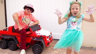 Stacy and Dad pretend play car wash