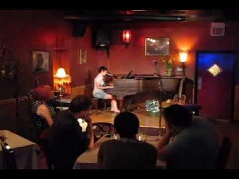 "Chicago musician Kim ""KJ"" Johnson, piano, vocals"
