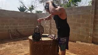 Fetching water from my well in Nigeria