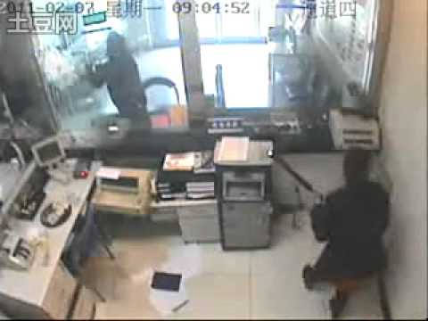 Bank Robber Proves That 'Bulletproof' Doesn't Mean 'Axe-Proof'