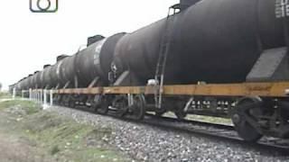 preview picture of video 'Cruzadas en Granadero Baigorria (3): Tren de NCA pasando por vía 2 hacia Rosario'