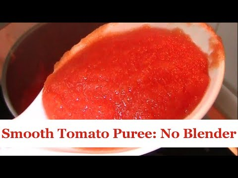 Puree Tomatoes And Other Vegetables With A Metal Sieve