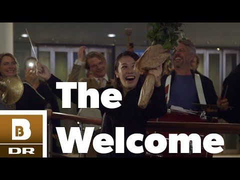 Danish band gives their new japanese conductor a surprise welcome at the airport