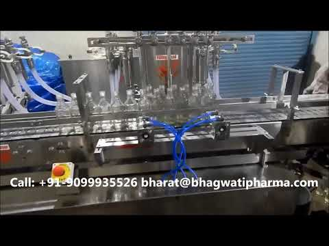 Twelve Head Volumetric Liquid Bottle Filling Machine