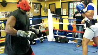 2nd round of me sparring for the first time (im in the red headgear) I was tired as hell.